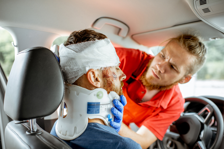 Man getting treatment after a car accident no seatbelt